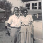 Horace and Sylvia by the car