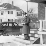 Horace in uniform in front of house